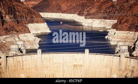 Aerial view of Hoover Dam and reservoir created by Lake Mead. - Stock Photo