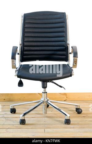 modern black leather office chair on wood floor over white background. - Stock Photo