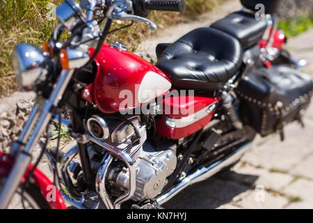 Classic motorcycle, close up view, depth of field effect. - Stock Photo