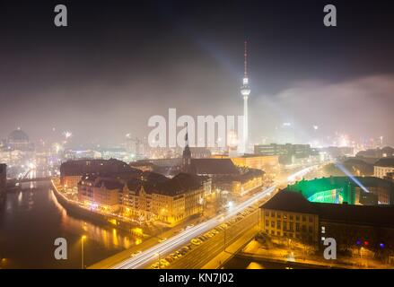 View over Berlin on New Years Eve 2013 with fireworks. - Stock Photo