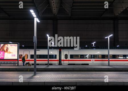 Deutsche Bahn ICE Bullet Train Closeup Side Train Station Parked Winter 2017 in Munich, Germany Hauptbahnhof - Stock Photo