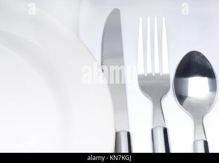 close up of a cutlery set on a table with napkin and dish. - Stock & Empty dining table set up outdoors on farm Stock Photo: 62719383 - Alamy