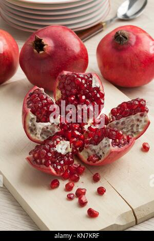 Open fresh red ripe pomegranate fruit and seeds. - Stock Photo