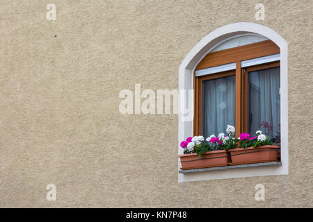 Cute European WIndow on Stucco Wall Texture Background with Copyspace - Stock Photo