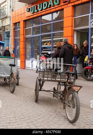 December 2017 - Tricycle cargo bikes parked in a street in Turkey - Stock Photo