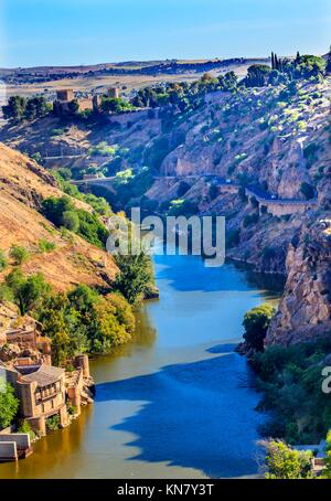 Tagus River Old Castle Fort Toledo Spain. Unesco historical site; Tagus is longest river in Spain. - Stock Photo