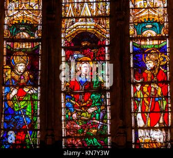 Bishops Lord Stained Glass Cathedral Spanish Flag Toledo Spain. Cathedral started in 1226 finished 1493. - Stock Photo