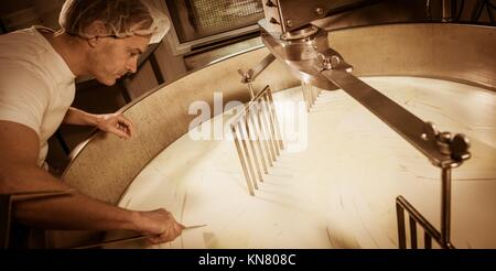 Cheesemaker -Traditional cheese making at a creamery,. - Stock Photo