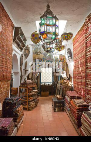 Antiques dealer and souvenirs shop indoors, Tangier, Morocco.