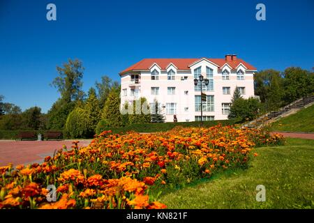 Apartment house with flowers on foreground summer, Russia, Moscow region - Stock Photo