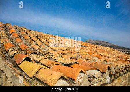Old tile roof close up ceramic house. - Stock Photo
