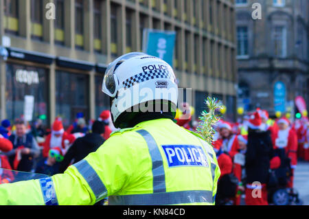 Glasgow, Scotland, UK. 10th December, 2017: Police motorcyclist in George Square at the start. Thousands of participants - Stock Photo