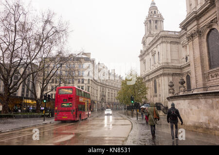 LONDON, UK. 10th Dec, 2017. Tourists walk past St Paul's Cathedral on St Paul's Churchyard in a heavy snow fall. - Stock Photo