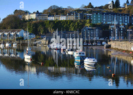 A wintery, snowy morning in Porthmadog harbour, Snowdonia, North Wales, UK on Monday morning, 11th of December 2017. - Stock Photo