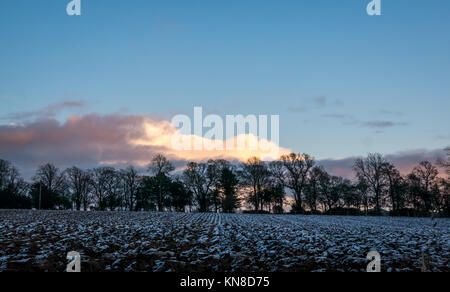 East Lothian, Scotland, United Kingdom, 11th December 2017. Orange and blue sunset over the frozen countryside in - Stock Photo