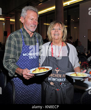 Munich, Germany. 11th Dec, 2017. Former national soccer player Paul Breitner and his wife Hildegard supporting the - Stock Photo