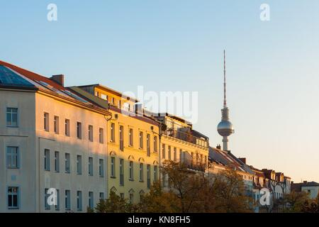 Apartments in Berlin's Prenzlauer Berg neighborhood with Fernsehturm. - Stock Photo