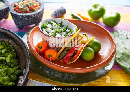Nopal taco mexican food with chili pepper and ingredients on colorful table. - Stock Photo