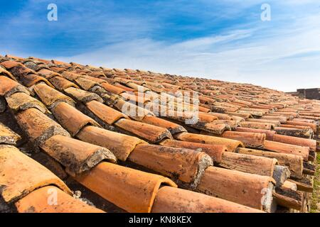 Old tile roof close up ceramic texture sky. - Stock Photo
