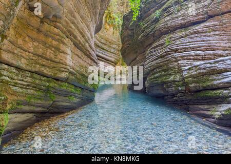 Beautiful canyon with rocks and still crystal water, Abkhazia, Caucasus mountains - Stock Photo