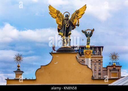 Laches Gate Saint Michael Peasant Girl Slavic Goddess Berehynia Statue on top Independence Monument, Symbol of Ukraine - Stock Photo