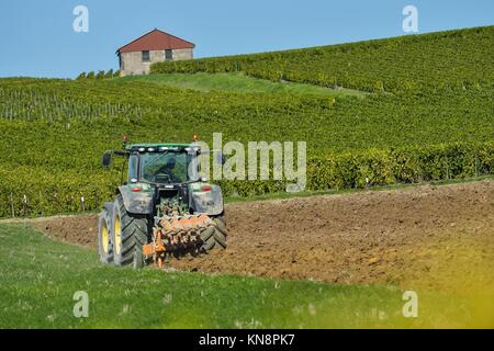 Tractor plowing the fields Champagne France Europe. - Stock Photo
