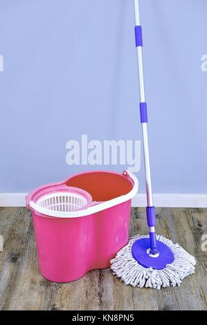 A studio photo of a cleaning mop. - Stock Photo