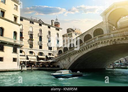 Rialto bridge and ship in Venice, Italy. - Stock Photo