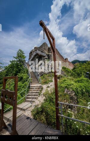 Gallows and guillotine in front of Ruined Poenari Castle on Mount Cetatea in Romania. - Stock Photo