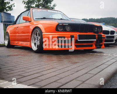 VILNIUS, LITHUANIA-AUGUST 20, 2017: Orange 1989 BMW M3 Cabrio (M30) in the rain. This model is one of the most popular - Stock Photo