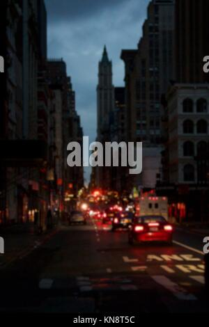 Background blur of darkness over blacked-out streets of Lower Manhattan in New York, NY, USA, after Hurricane Sandy. - Stock Photo