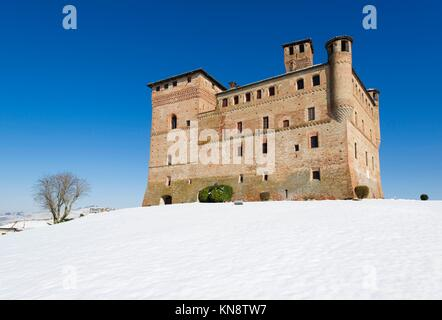 View of the Castle of Grinzane Cavour in winter with snow, Langhe Piedmont Italy Unesco heritage. - Stock Photo