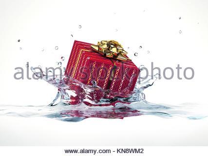 Decorated gift falling into water splashing. On white background. - Stock Photo