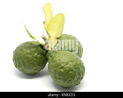 close up group of fresh bergamot with green leaves isolated on white background. benefits of bergamot for beauty - Stock Photo