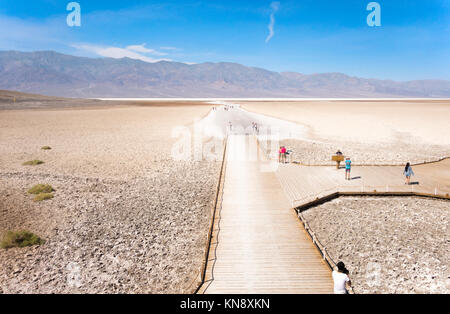 Death Valley Badwater Basin. Trailhead and boardwalk with visitors. Death Valley National Park California - Stock Photo