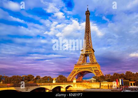 Eiffel tower at sunset in Paris France. - Stock Photo