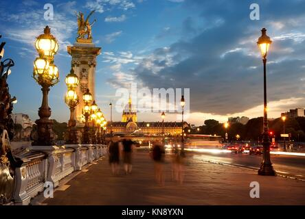 View on Les Invalides from bridge Alexandre III in Paris at sunset, France. - Stock Photo