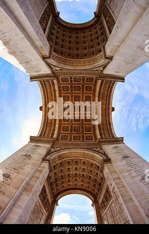 Arc de Triomphe in Paris Arch of Triumph low angle view at France. - Stock Photo