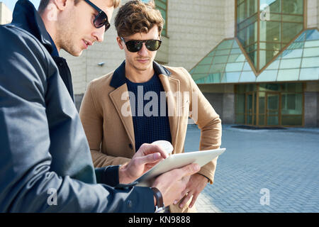 Two Handsome Businessmen Using Tablet Outdoors - Stock Photo