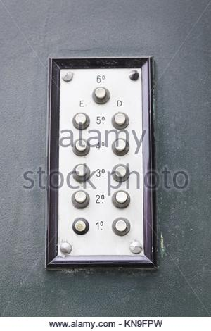 Old intercom in a house, detail of a electric apparatus in the facade of a building. - Stock Photo