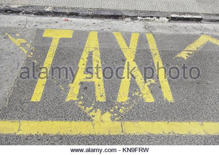 Taxi sign on asphalt, detail of a traffic signal, information and tansporte. - Stock Photo