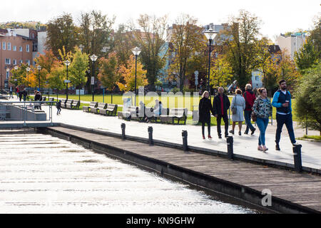 View of people walking in parkland in the Autumn on mill Island in the Polish city of Bydgoszcz Poland - Stock Photo
