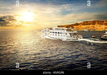 White yachts in Red sea at the sunset. - Stock Photo