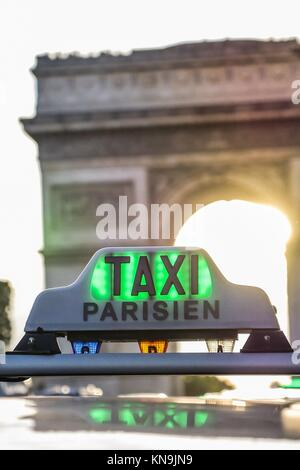 Paris taxi detail and Arc de Triomphe in the background, France. - Stock Photo