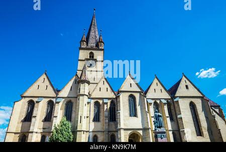 Georg Daniel Teutsch monument in front of Saint Mary Lutheran Cathedral in Sibiu city in Romania. - Stock Photo