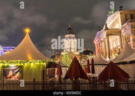 View over the Christmas Market 'Weihnachtszauber Gendarmenmarkt' with the New Church (Deutscher Dom) & Konzerthaus - Stock Photo
