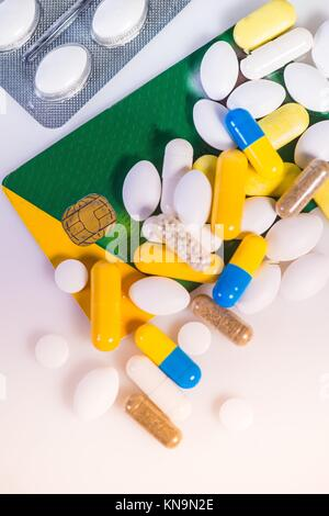 French Carte Vitale, Social Security Card, with pills. - Stock Photo