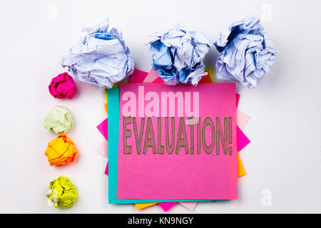 Writing text showing Evaluation written on sticky note in office with screw paper balls. Business concept for Assessment - Stock Photo