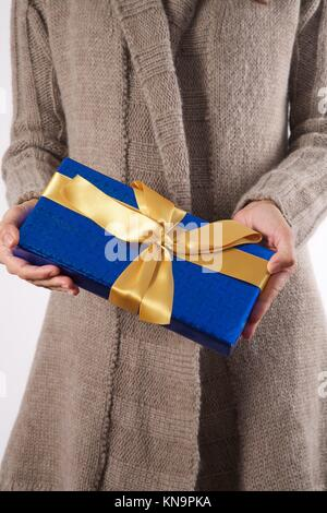 woman detail with a gift box in her hands. - Stock Photo