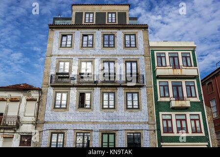 Blue and green Azulejo facades of residential buildings on Rua de Dom Manuel II street in Porto city on Iberian - Stock Photo